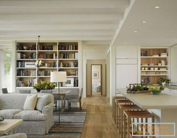 Beautiful interior of the hall with a kitchen in a private house in a modern style