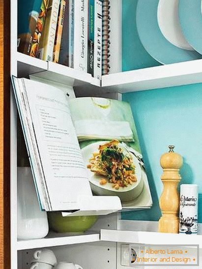 Books and utensils in a small kitchen in turquoise color