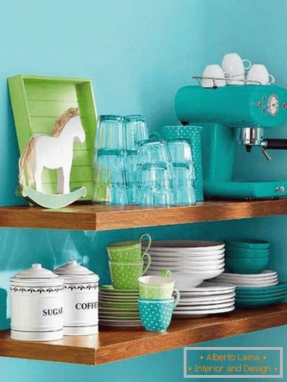 Bright dishes in a small kitchen in turquoise color
