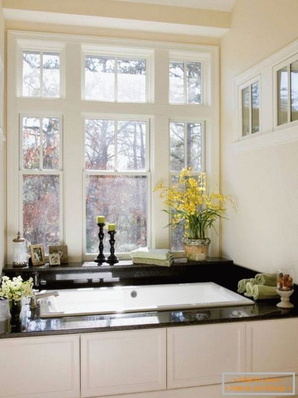 Decorating the window sill with flowers and other decor