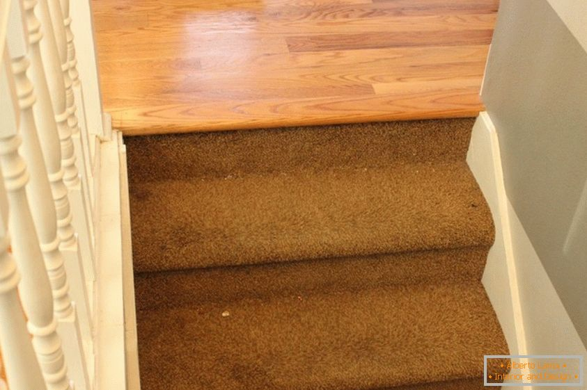 Staircase with an old carpet - top view