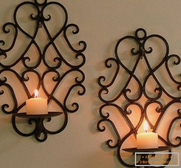 Wall-mounted forged candlestick in classic style