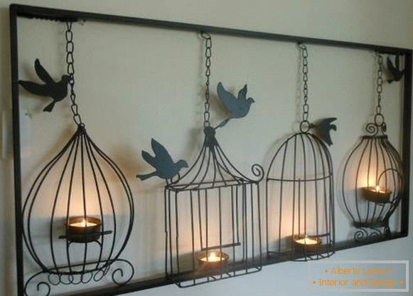 Forged candlesticks in the form of bird cells