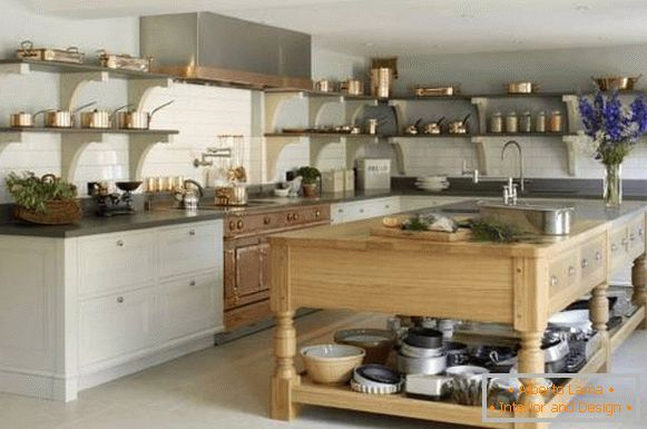 Open shelves of copper tableware in kitchen design