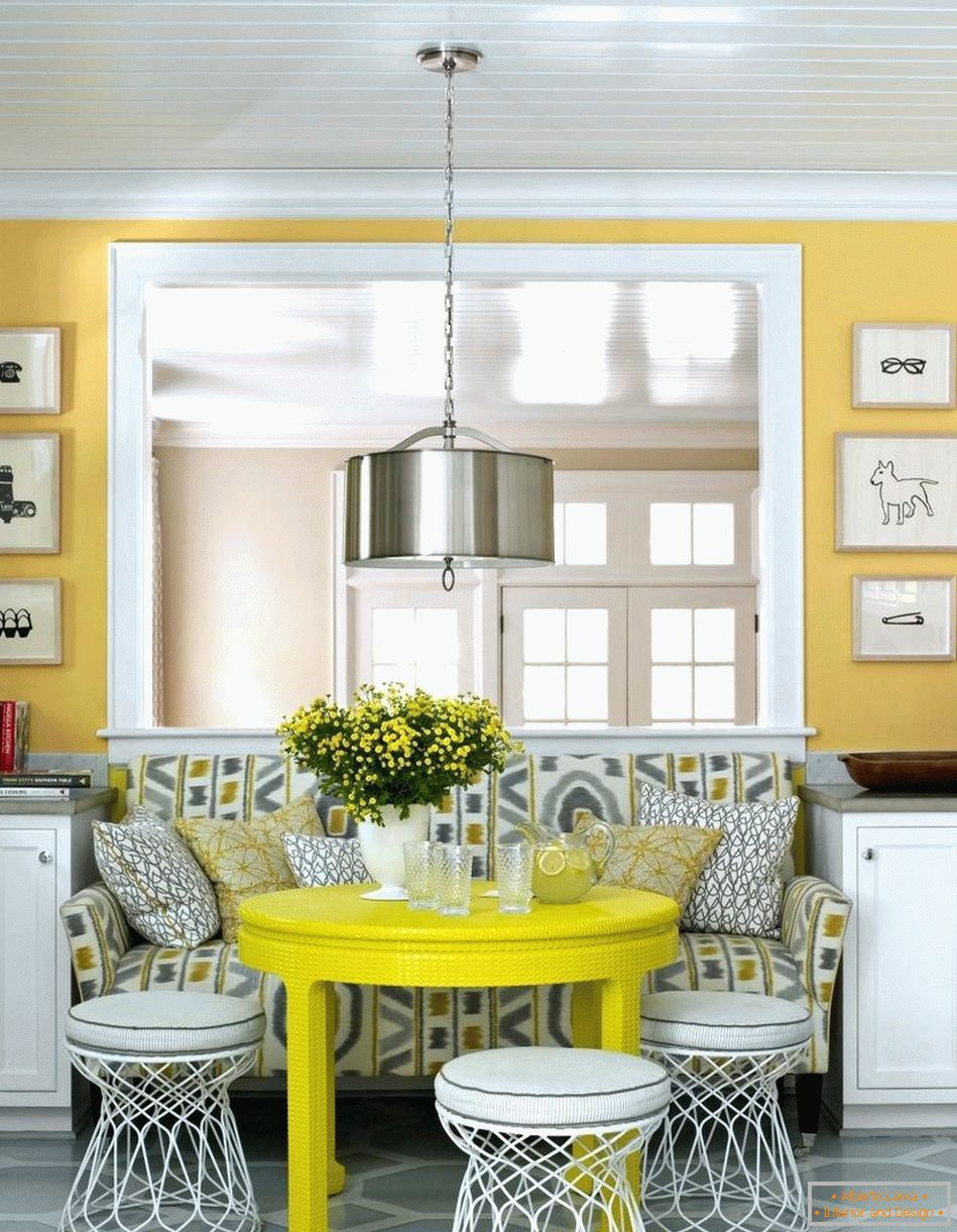 White chairs around the yellow table