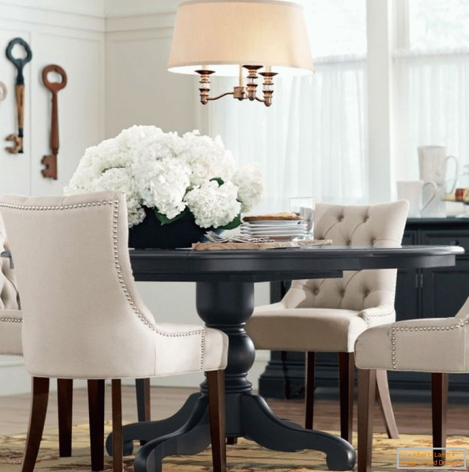 Beige chandelier above the gray table