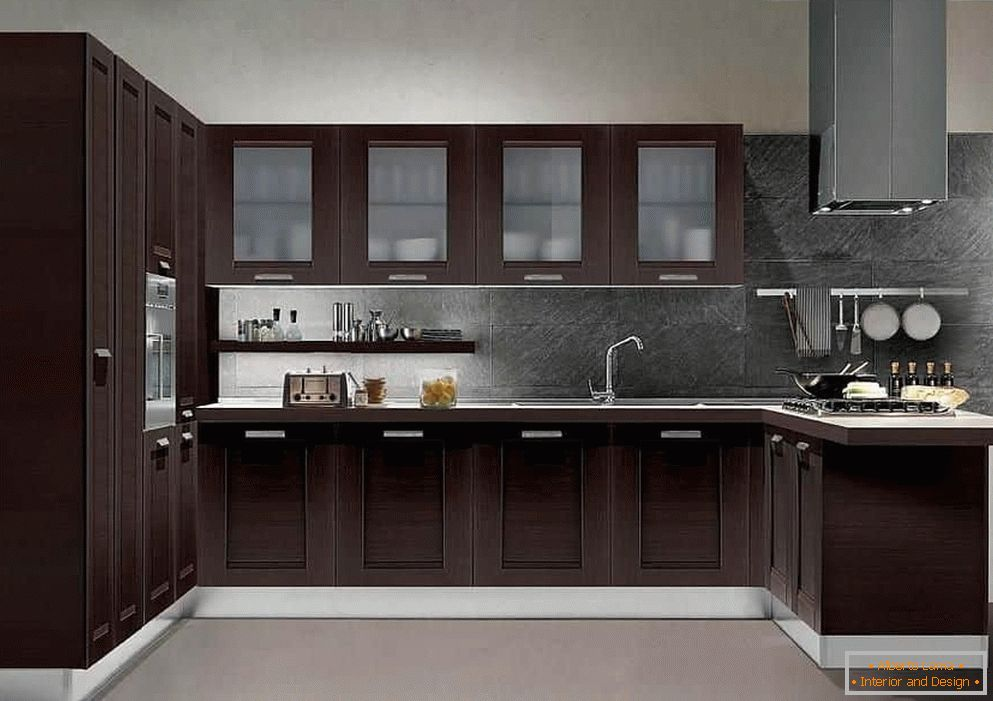 Classical U-shaped kitchen with a hood on the ceiling