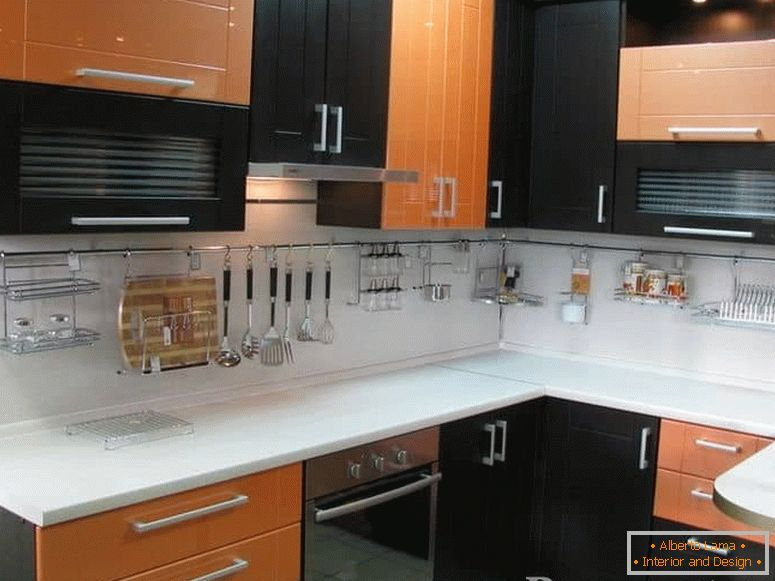 Combination of orange with Wenge color in a corner kitchen