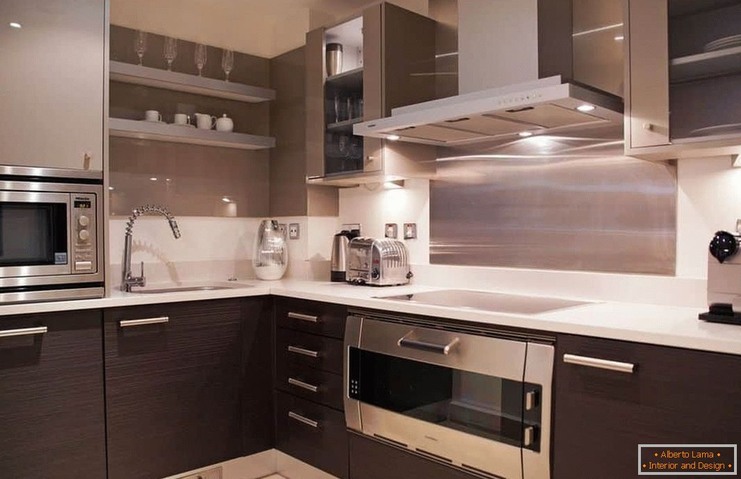 The combination of metallic shades and wenge in a square kitchen