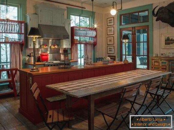 Kitchen design in a rustic style in red and green tones