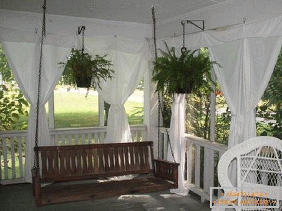 Decorative decorations in a summer kitchen with a veranda, photo 2