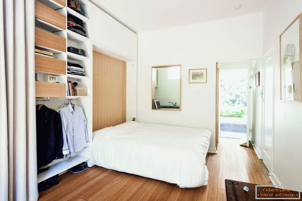 Folding bed in a small studio apartment