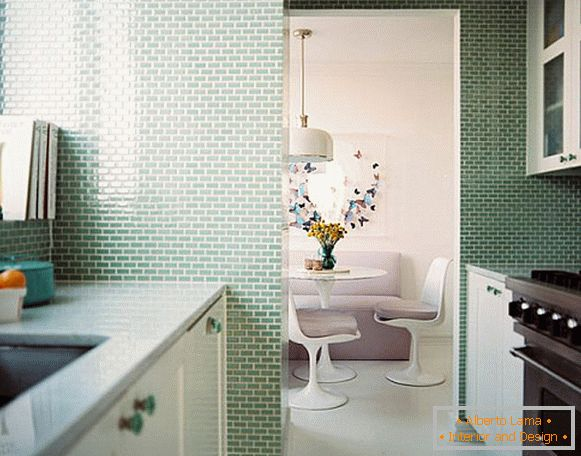 Small kitchen with soft green tiles