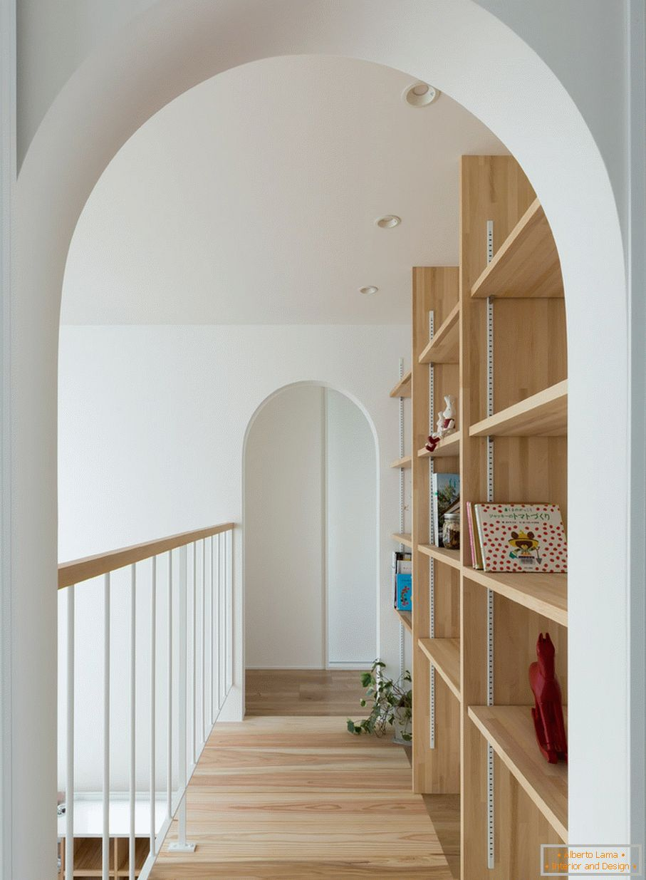 Arches on the second floor of a small house