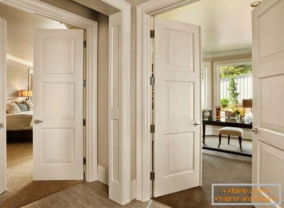 Beautiful interior doors in the interior - a photo in white