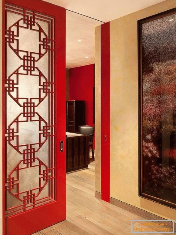 Red doors in the interior of the apartment - photo