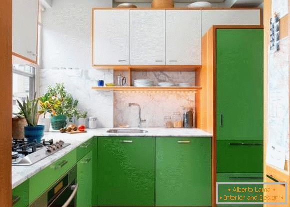 A small kitchen in white and green tones