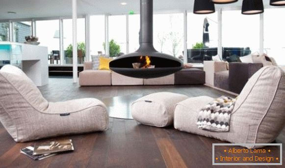 Armchairs-bags in an unusual fireplace