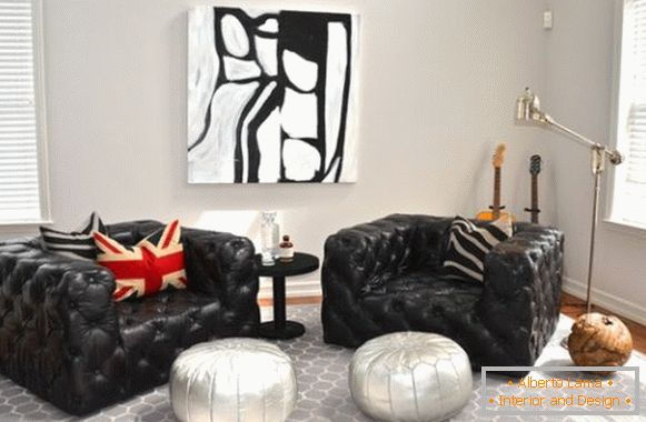 Black armchairs and white ottomans