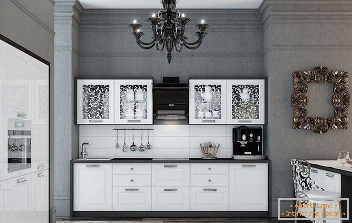 The kitchen is made in an advantageous combination of contrasting white and black colors. Glossy surfaces gracefully fit into the interior in the neoclassic style.