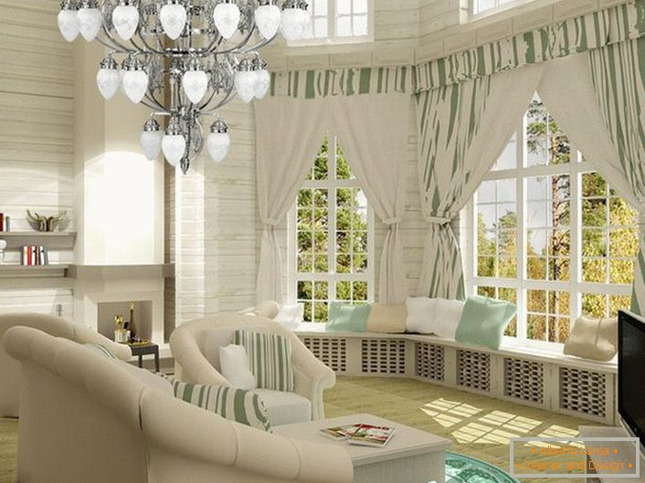 Bright living room in neoclassic style. Cozy and at the same time functional space. Of particular interest are the wide sills decorated with pillows.