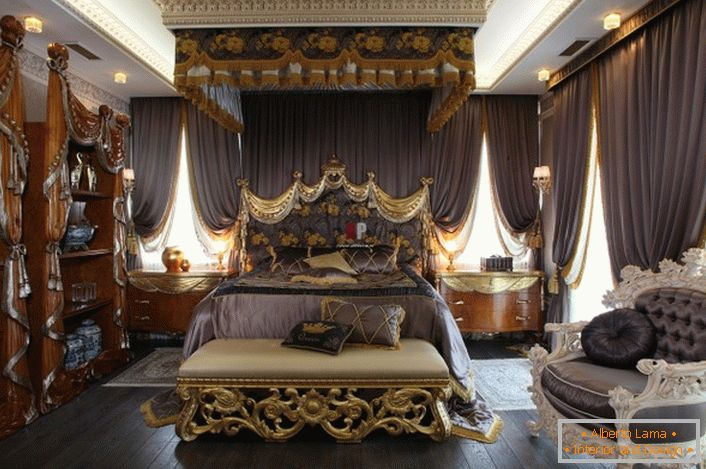 Luxury bedroom in Baroque style. In the center of the composition is a massive bed with a high decorated headboard.