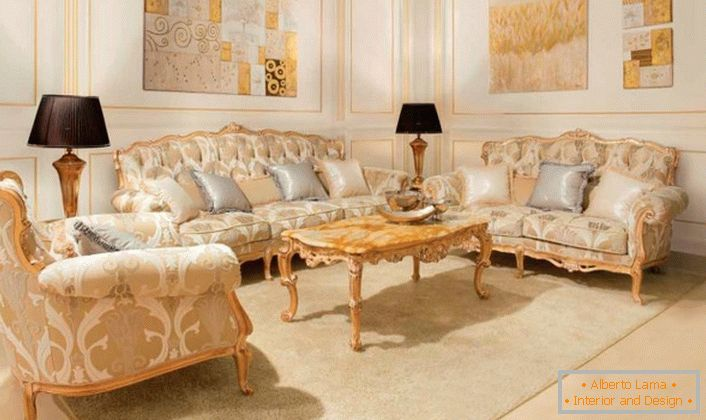 Upholstered furniture with wooden elements of gold color is in harmony with the golden panels on the walls.