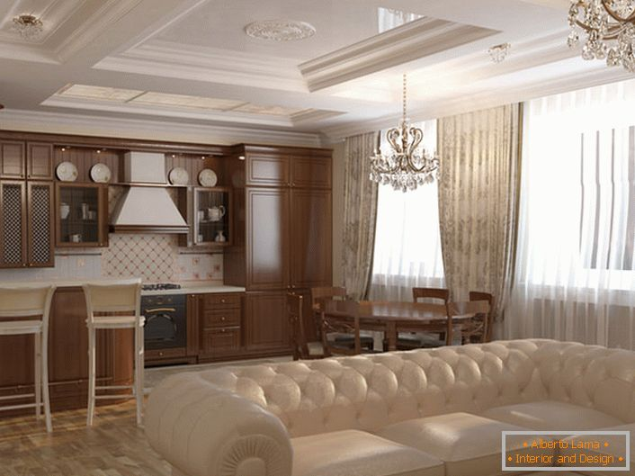 Kitchen-living room is decorated in Art Nouveau style. Light colors, furniture from natural wood, massive ceiling chandeliers made of crystal are matched in accordance with the style.