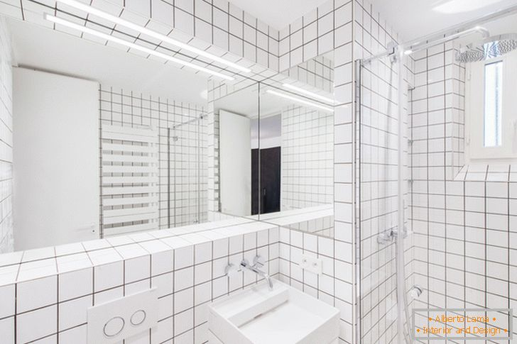 Large mirror with illumination in the bathroom