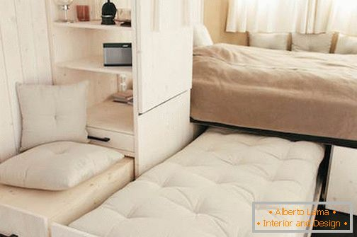 Bedroom in mobile home on wheels
