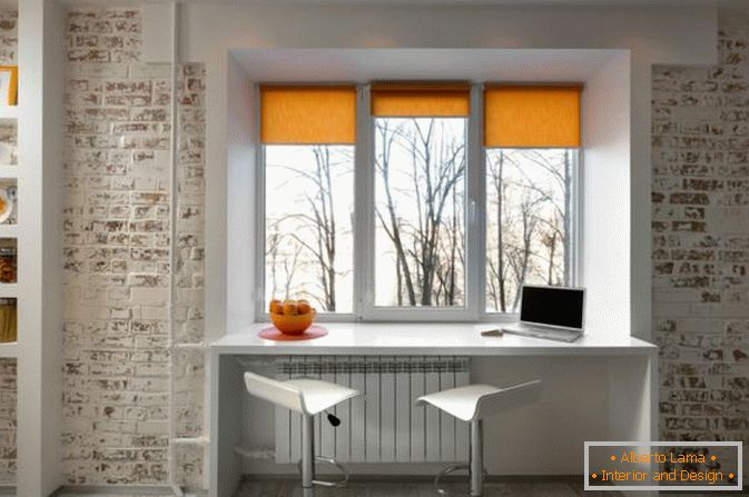 Cabinet at the window in a small studio apartment