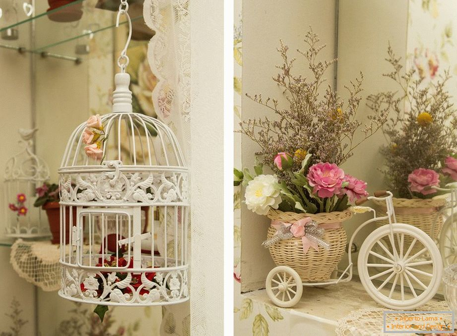 White cage and flowers in a basket on a light cozy kitchen