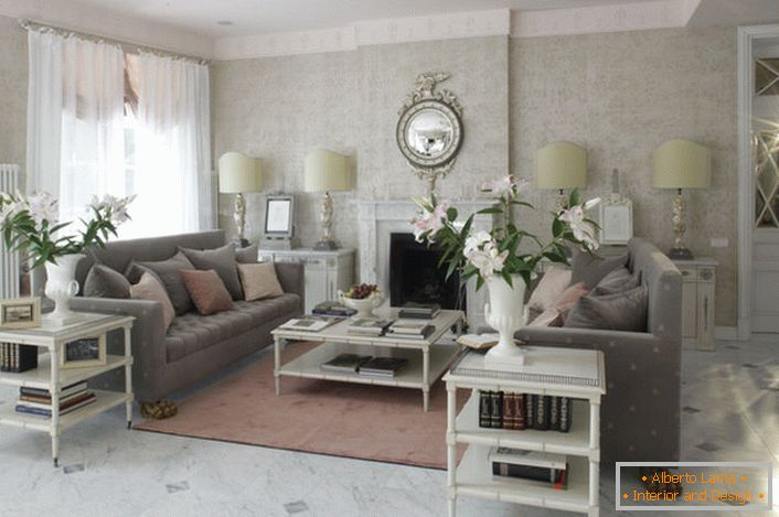 The French-style living room is decorated in light colors. In the room there is a romantic, cozy atmosphere.