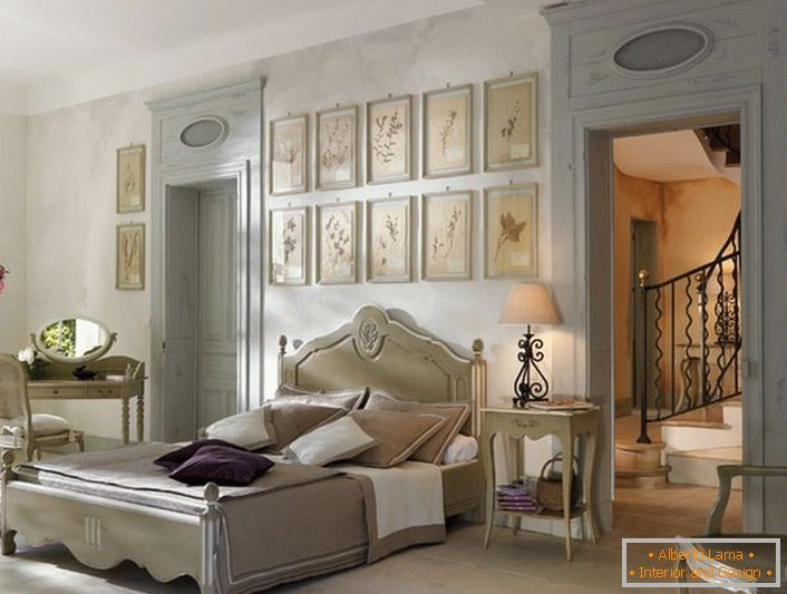 In accordance with the traditions of the French style for the bedroom was selected laconic light furniture of wood. An interesting detail is a collage of pictures above the head of the bed.