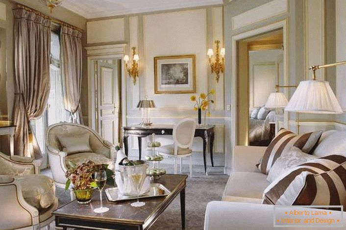 A small guest room is designed in accordance with the requirements of the French style. A good example of lighting for the living room.