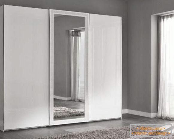 The ideas of the wardrobe in the bedroom in white with a mirror
