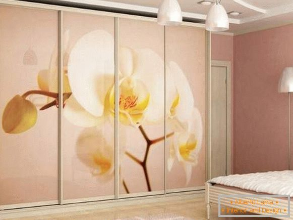 Delicate bedroom with wardrobe compartment with photo printing
