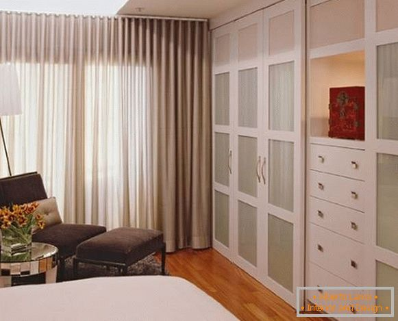 Small bedroom with stylish wardrobe