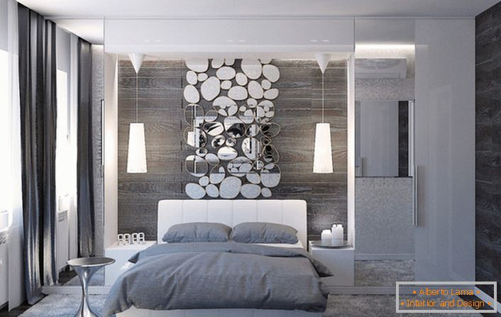 The wall above the head of the bed is decorated with a stylish collage of oval-shaped mirrors.