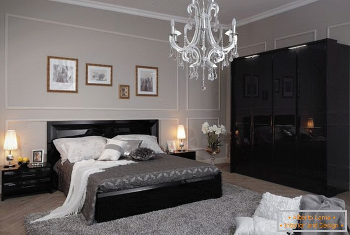 A cozy and stylish bedroom in high-tech style, made in light gray tones, with contrasting black furniture.