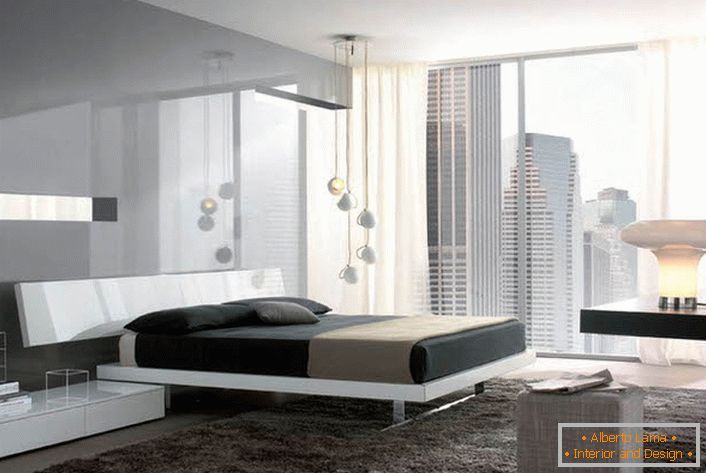 Glossy surfaces with a metallic luster make the hi-tech bedroom more spacious and light.