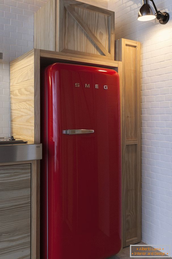 Red refrigerator in the interior design of a small apartment
