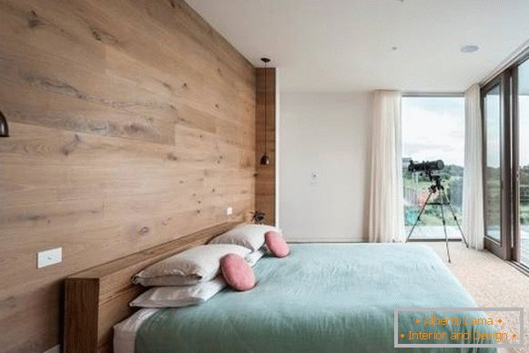 Decorating the walls with a tree - a photo of a modern bedroom