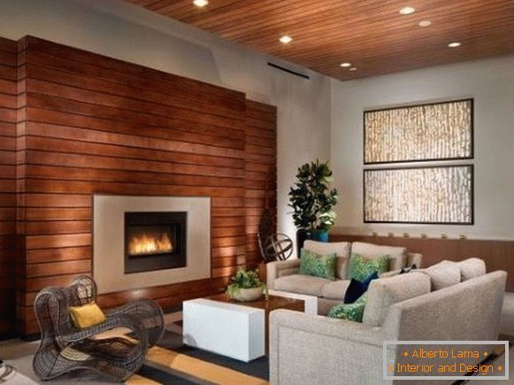 Decorative wall decoration with wood - boards on the wall with a fireplace
