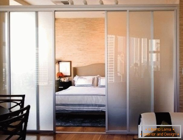 Glass partition in the bedroom of the living room