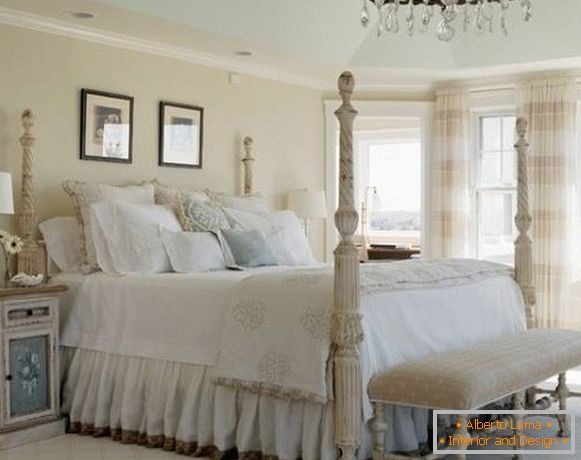 The bedroom in the style of the shebbie chic with a large bed with columns