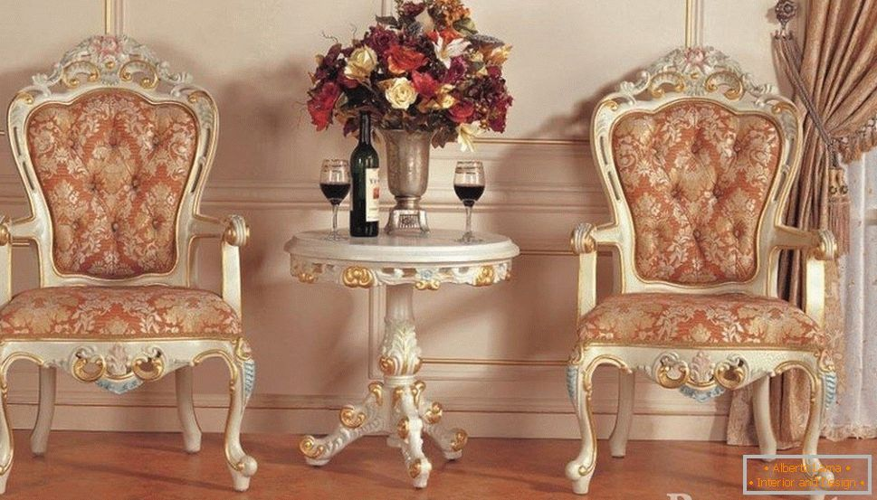 Wine on the table and chic chairs