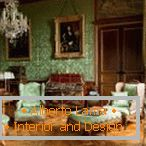 Green furniture in combination with green wallpaper