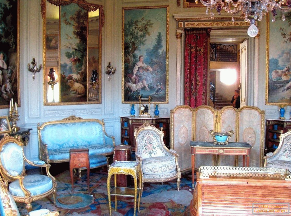 Hall with paintings and chic furniture