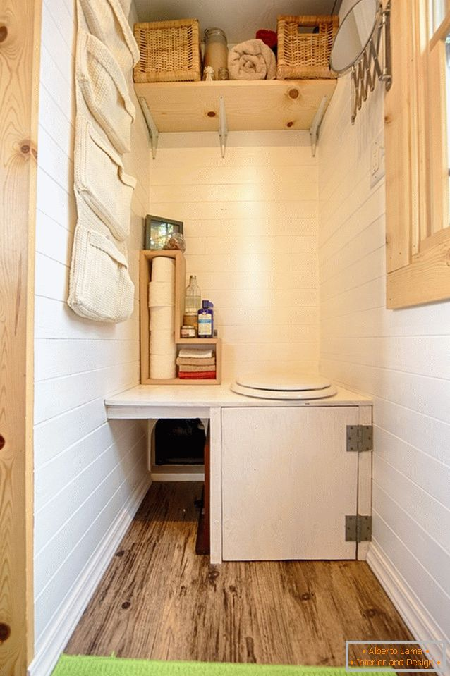 A bathroom of a small wooden cottage